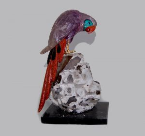 CARVED BIRD IN AMETHYST GOLD STONE